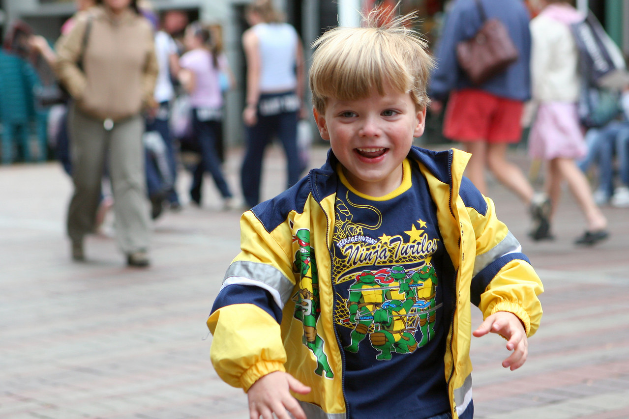 Another grab shot - I love the expression of pure joy on my son's face and the wonderfully shallow depth of field here. I think everything in this shot works to draw your eye to Sasha, while also providing enough information to let you know this was taken on a busy city street.