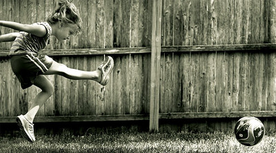Carolyn playing around in the back yard.