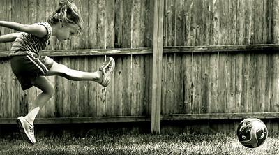 Carolyn playing around in the back yard.