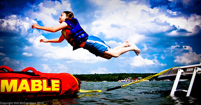 """Carolyn leaping from our boat to the """"Big Mable"""" tube"""