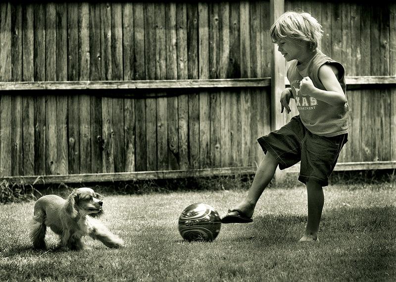 Matt trying to kick the ball past Penny.