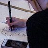 Maddie Dowdle drawing her final project ideas at Utah State University's printmaking studio in Logan, Utah, Nov. 29, 2017. Dowdle is in an intro to printmaking class where students get the chance to explore a variety of different printmaking methods. (Megan Nielsen/USUPJ)