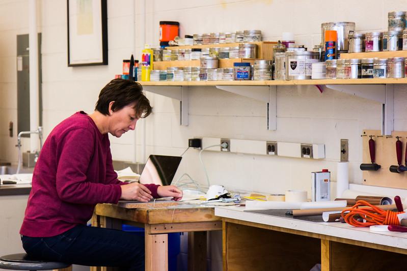 Kathy Puzey, the Associate Professor of Printmaking, works on a block print at Utah State University's printmaking studio in Logan, Utah, Nov. 29, 2017. The printmaking program at USU encourages creativity by incorporating various print media, including intaglio, lithography, relief and screen printing. (Megan Nielsen/USUPJ)