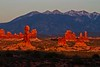 La Sal Mountains make a backdrop for columns at Arches.<br /> Photo © Carl Clark