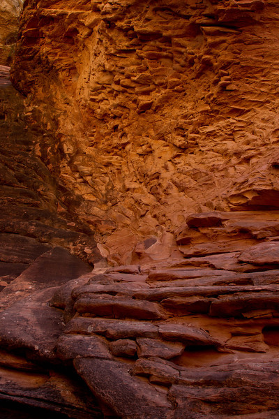 Colors glow in a narrow canyon on a hike in Canyonlands' Needle District.<br /> Photo © Cindy Clark