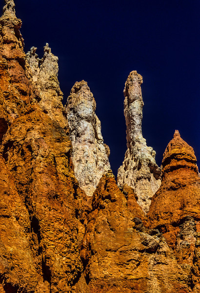 Multi-colored hoodoos on the Fairyland trail in Bryce Canyon.<br /> Photo © Carl Clark