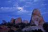 Moon emerging at Arches.<br /> Photo © Carl Clark
