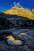 First light of the day reflected off Checkerboard Mesa in Zion.<br /> Photo © Carl Clark