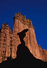 The Cobra silhouetted against The Titan at Fisher Towers. The Cobra is no longer as the top broke off in 2014.<br /> Photo © Carl Clark