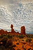 A carpet of clouds sets off Balanced Rock in Arches Nat'l Park.<br /> Photo © Carl Clark