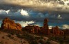Early morning clouds at sunrise make a dramatic backdrop at Arches.<br /> Photo © Cindy Clark