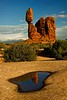 Balanced Rock balances in  a pool in Arches.<br /> Photo © Carl Clark