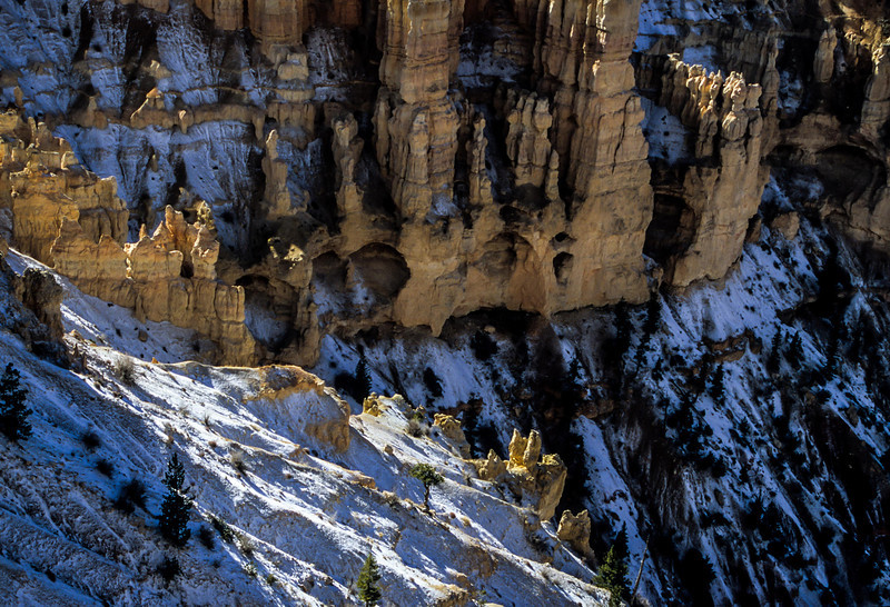 A fresh snow dusting on the cliffs at Bryce Point.<br /> Photo © Carl Clark