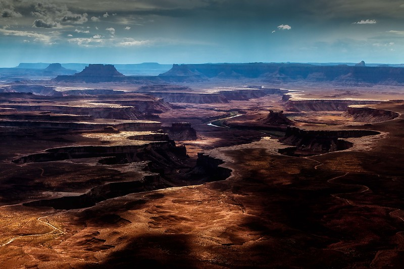 Sunspots chase over the plateaus cut by the Green River at Island In The Sky, part of Canyonlands.<br /> Photo © Cindy Clark