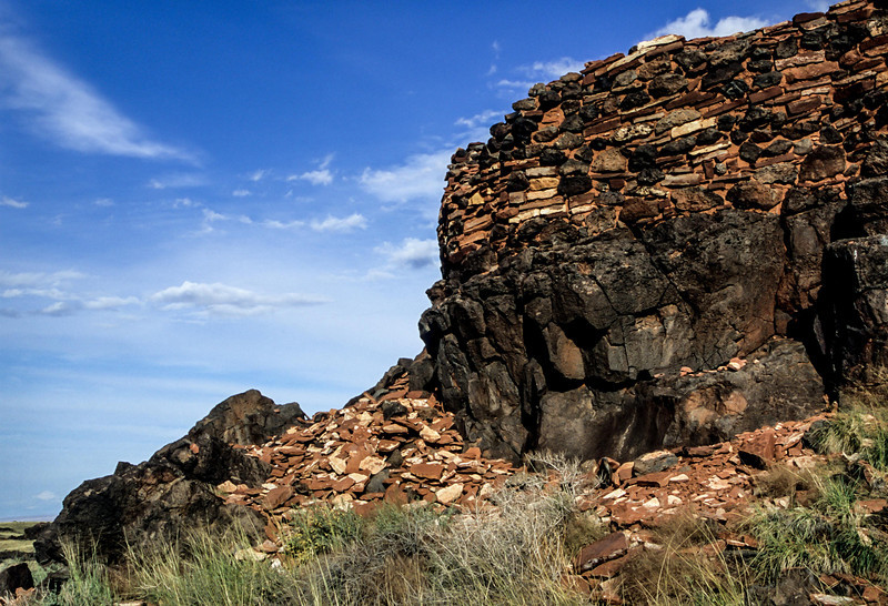 Crumbling remnants litter the ground around Wupatki Pueblo near Sunset Crater. <br /> Photo © Carl Clark