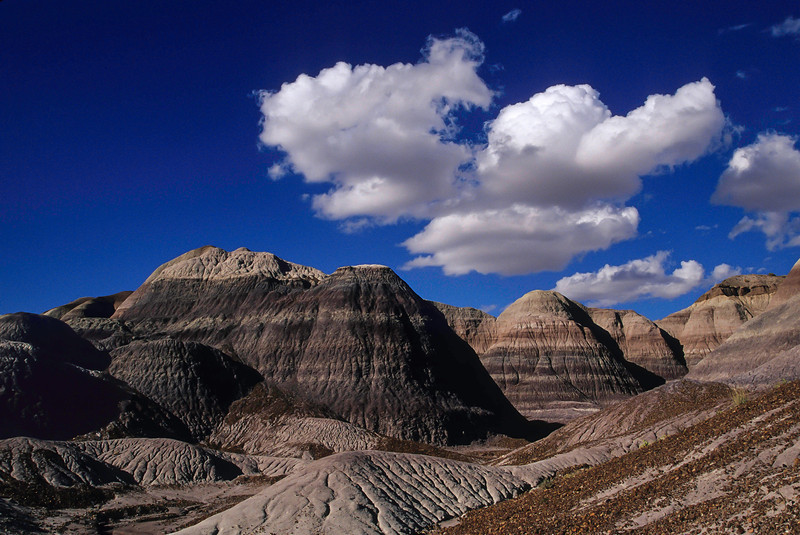 Clouds sail over the Painted Desert.<br /> Photo © Cindy Clark