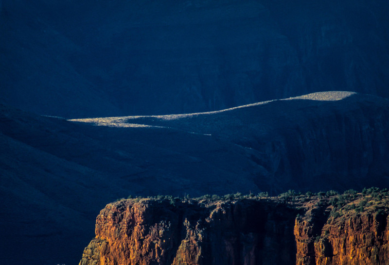 A ribbon of light above cliffs on the North Rim of the Grand Canyon.<br /> Photo © Carl Clark