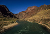 The Colorado River glides through the Grand Canyon on a perfect day.<br /> Photo © Carl Clark