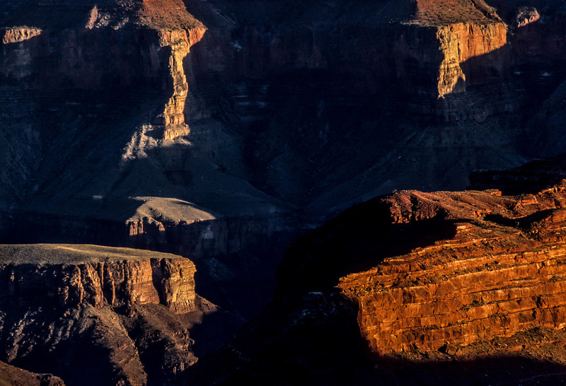 Low angled sun highlights forms viewed from the North Rim of the Grand Canyon.<br /> Photo © Carl Clark