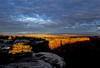 Spotlights of sun start the day at Canyon de Chelly.<br /> Photo © Carl Clark