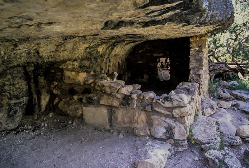 Remnants of a cliff dwelling hidden in the hillside in Walnut Canyon.<br /> Photo © Carl Clark