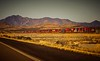 Freight train parallels Highway 10  just over the Arizona/New Mexico state border.<br /> Photo © Cindy Clark