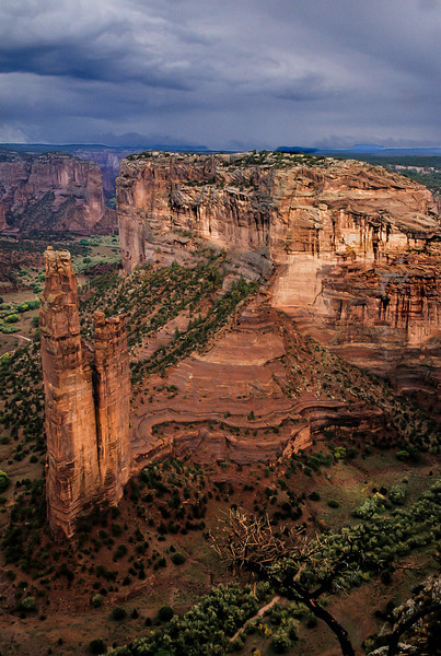 The sun breaks through on Spider Woman Rock after a storm at Canyon de Chelly.<br /> Photo © Cindy Clark