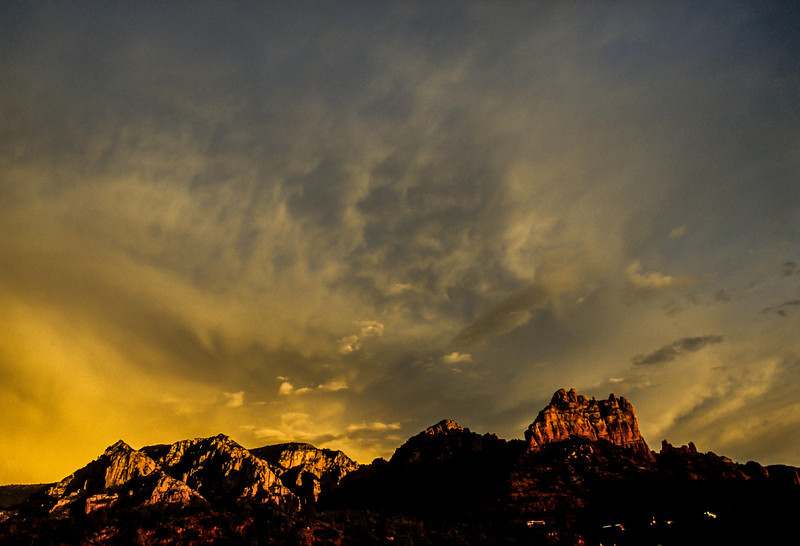 A sunset storm adds drama to the red peaks near Sedona.<br /> Photo © Carl Clark