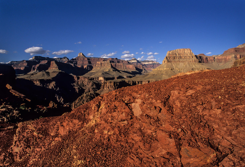 Red rock sets of the grandeur of the Grand Canyon on South Kaibab trail.<br /> Photo © Carl Clark