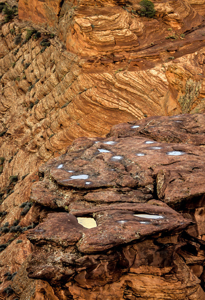 Remnants of a recent rain fill potholes at Canyon de Chelly.<br /> Photo © Carl Clark