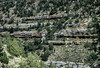 Difficult to see cliff dwellings constructed in the 12th century in Walnut Canyon.  Look particularly below the 3rd cliff band from the top.<br /> Photo © Carl Clark