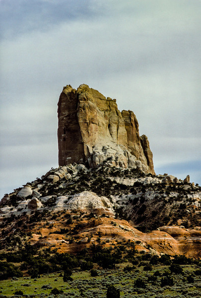 Agathia Peak stands tall near Monument Valley.<br /> Photo © Carl Clark