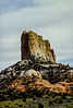 Agathia Peak stands tall near Monument Valley.<br /> Photo © Carl Clark