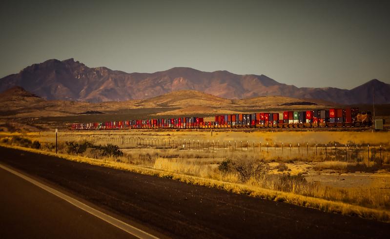 A freight train chugs southwest into Arizona.<br /> Photo © Cindy Clark