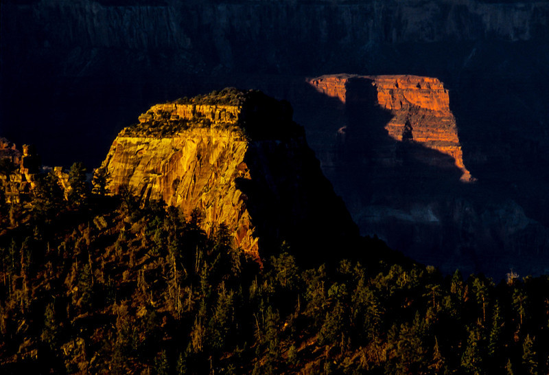 Rock outcrops catching the last of the sunlight in the Grand Canyon.<br /> Photo © Carl Clark