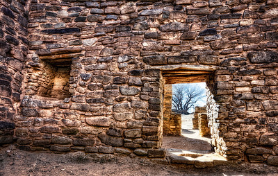 The Anasazi Indians lived in these Aztec New Mexico rooms darkened by rooftops.  Now sunlight bathes the walls of these ruins.