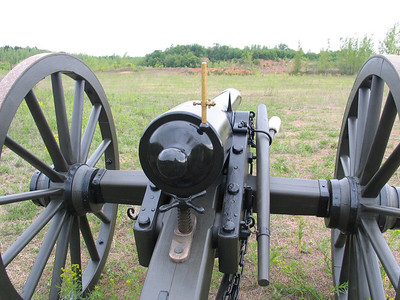 This civil war canon is about 450 yards from the bank in the distance where there are two targets, each about 18 inches square. Before the day is done both targets will be hit, along with several 5 gallon water-filled buckets.