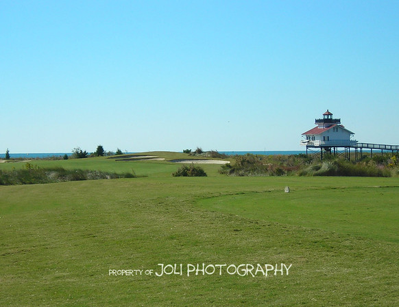 # 2 at the Arnold Palmer course flanked by the Old Plantation Flats Lighthouse.