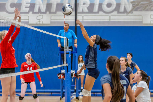 Saugus senior Brianna Plunk tips the ball over the net in a matchup with Taft at Saugus High School Wednesday evening.  Cory Rubin/The Signal