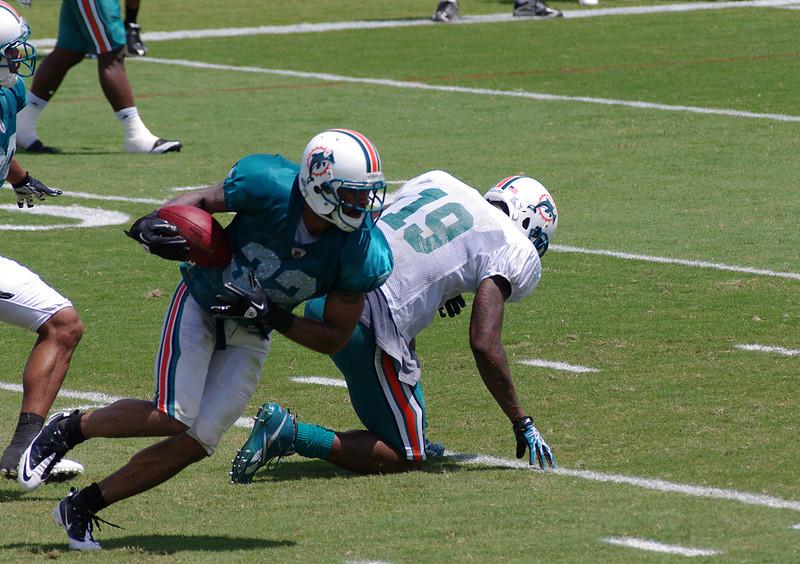 Jason Allen, cornerback, intercepts the ball from Brandon Marshall, wide receiver, Miami Dolphins Training Camp, Davie, Florida August 2010
