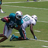 Jason Allen, cornerback, intercepts the ball from Brandon Marshall, wide receiver, Miami Dolphins Training Camp, Davie, Florida August 2010