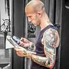 Brighton Tattoo Man Checks Classifieds