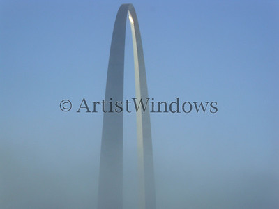 St. Louis Arch with low fog surrounding it.
