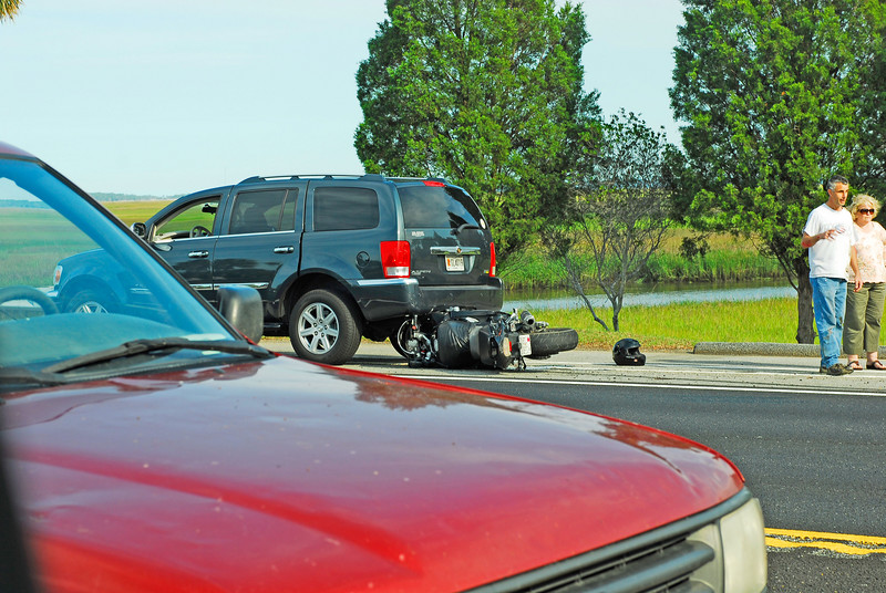 Two Accidents - Motorcycle hits car then accident occurs by passerbys in the opposite lanes