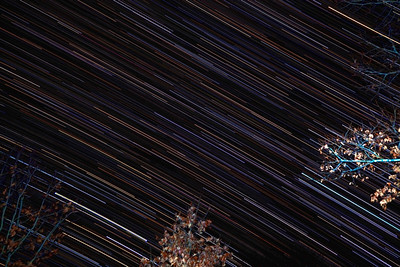 This is 81 images of 25 seconds each. Layered in Photoshop CS4. Taken from my backyard at 2am.