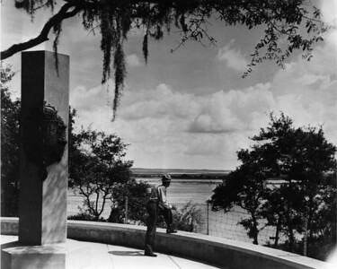 A park ranger viewing the St. Johns River from the Ribault Monument at the Fort Caroline National Memorial in 1959.
