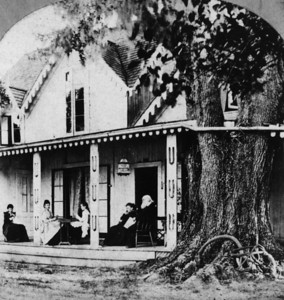 Mr. and Mrs. Stowe are sitting on the porch with their children. The Stowes wintered in Mandarin. Image taken sometime between 1869 and 1878.