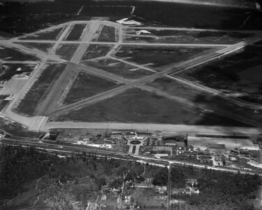 An aerial view overlooking Imeson Field.  Imeson Field opened in 1927 and was the center of the First Coast's commercial aviation scene for over 40 years.  Upon completion of the Jacksonville International Airport, Imeson Field was abandoned in 1968.