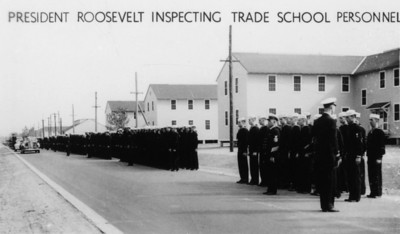 President Franklin D. Roosevelt inspecting trade school personnel at the Naval Air Station during WWII.