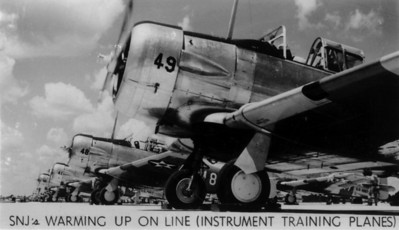 SNJ's warming up on line (instrument training planes) at Naval Air Station Jacksonville during the 1940s.